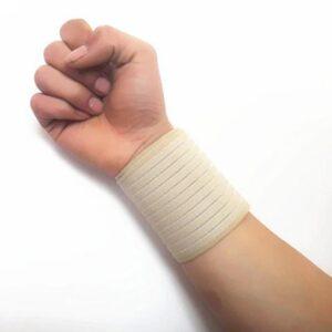 Elastiskt enkelt handledsstöd - beige