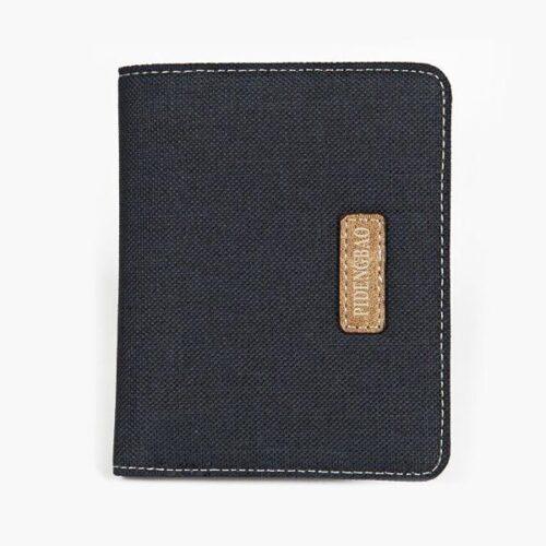 Plånbok i kanvastyg och läder - svart vertikal