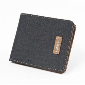 Plånbok i kanvastyg och läder - svart